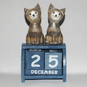 Two Cats With a Blue Calendar