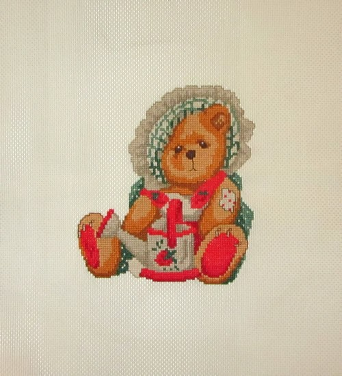 Cross Stitch Embroidery picture of a teddy bear with a watering can for framing