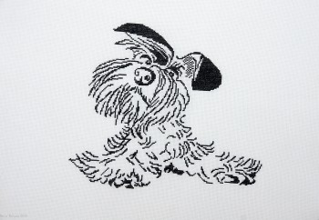 Cross Stitch Embroidery picture of a black doggy for framing