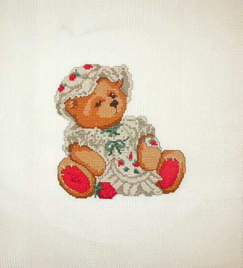 Cross Stitch Embroidery picture of a teddy bear with needlework for framing