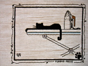"Cross Stitch Embroidery picture of a cat and text saying ""Purrma-press"" for framing"