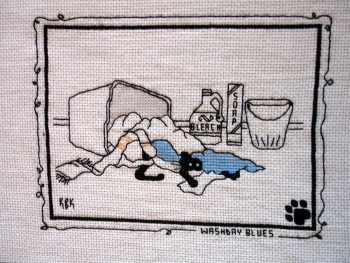 "Cross Stitch Embroidery picture showing a cat and text saying ""Washbay Blues"" for framing"