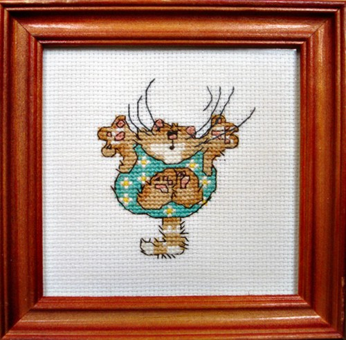 Framed Cross Stitch Embroidery picture of a cat in a green jumpsuit